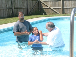 Isabella with Dad (left) and Pastor (right) coming up out of the water after her baptism